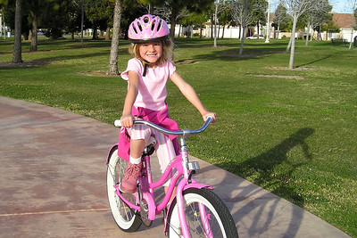 Sydney enjoying a bike ride in the park across the street from the house.