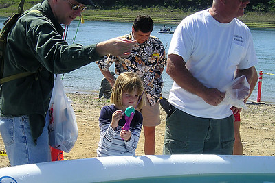 Pat and Sydney Kane at a pool stocked with trout during a kids' fishing day organized by the Casitas Municipal Water District  at Lake Casitas.