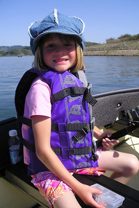 We needed a break from the crowds, so we headed out onto Lake Casitas in our Porta-Bote. Sydney Kane is hoping to catch only little ones!