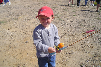 Christopher Kane is ready to catch some trout at Lake Casitas, where the Casitas Municipal Water District had organized a kids' fishing day. He's enjoying the casting games they had set up, while Dad stood in line for the trout pool.