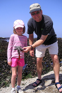 Sydney and Pat with a starfish at the tide pools in Corallina Cove at Montaña de Oro State Park. Our timing was perfect as the tides were at their lowest for the month of April.