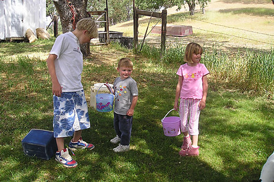 Nathan Roth is helping Christopher and Sydney Kane with the Easter egg hunt at the Roth household in Lockwood.
