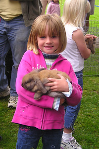 Sydney Kane with a rabbit at the Los Osos Easter Egg hunt.