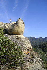 Betsy Roth is enjoying the view overlooking the San Antonio River from atop the interesting rock formations around Wagon Cave in the Los Padres National Forest.
