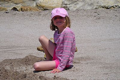 Sydney Kane playing in the coarse sand in Corallina Cove at Montaña de Oro State Park.