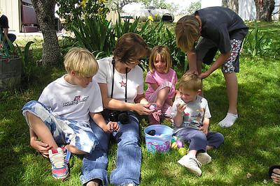 Nathan, Besty and Grady Roth with Sydney and Christopher Kane checking out the Easter eggs found at the Roth household in Lockwood.