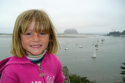 Sydney Kane on the hillside above the Morro Bay Museum of Natural History overlooking the bay and Morro Rock.