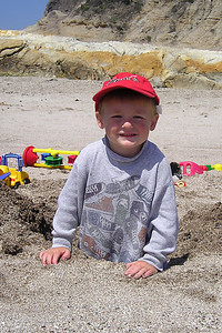 Christopher Kane playing in the coarse sand in Corallina Cove at Montaña de Oro State Park.