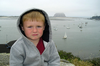 Christopher Kane on the hillside above the Morro Bay Museum of Natural History overlooking the bay and Morro Rock.