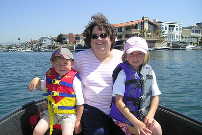 Sydney and Christopher enjoying the boat ride with their aunt, Kathy Kane, in Channel Islands Harbor.