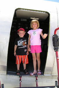 """Christopher and Sydney Kane aboard the C-46-F #N53594 Curtiss """"Commando"""" Army Air Corps transport (""""China Doll"""") at the World War II Aviation Museum at Camarillo Airport. The museum is operated by the Southern California Wing of the Commerative Air Force."""