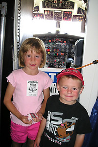 """Sydney and Christopher Kane outside the cockpit of the C-131D (CV-340/T-29) #N131CW Convair """"Samaritan"""" Air Force transpor at the World War II Aviation Museum at Camarillo Airport, which is operated by the Southern California Wing of the Commerative Air Force."""