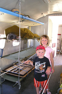 """Sydney and Christopher Kane aboard a C-131D (CV-340/T-29) #N131CW Convair """"Samaritan"""" Air Force transpor at the World War II Aviation Museum at Camarillo Airport. The museum is operated by the Southern California Wing of the Commerative Air Force."""