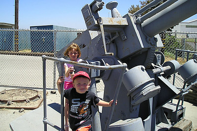 Sydney and Christopher Kane on an anti-aircraft gun at the World War II Aviation Museum at Camarillo Airport, which is operated by the Southern California Wing of the Commerative Air Force.