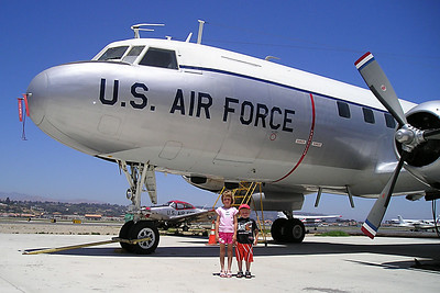 """Sydney and Christopher Kane in front of a C-131D (CV-340/T-29) #N131CW Convair """"Samaritan"""" Air Force transport at the World War II Aviation Museum at Camarillo Airport. The museum is operated by the Southern California Wing of the Commerative Air Force."""