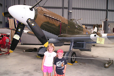 Sydney and Christopher Kane in front of a Supermarine Spitfire MKXIV at the World War II Aviation Museum at Camarillo Airport. The museum is operated by the Southern California Wing of the Commerative Air Force. Information from the museum web site: The Supermarine Spitfire Mark XIV #N749DP was built at the Aldermaston factory, Berkshire, England as NH749, and was shipped to Karachi, India in July, 1945 for anticipated operations in Southeast Asia. It is doubtful if the aircraft ever saw operational use by the RAF... It is a shining example of the legendary plane that was so instrumental in turning the tide over England against the Luftwaffe.