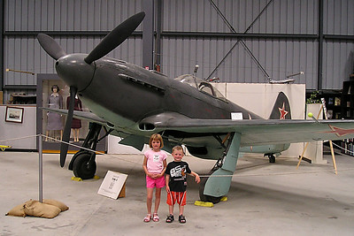 Sydney and Christopher Kane in front of a Russian Yakovlev YAK-3 at the World War II Aviation Museum at Camarillo Airport,. The museum is operated by the Southern California Wing of the Commerative Air Force. The Russian Yakovlev Yak-3 fighter plane debuted in 1944 and quickly dominated the skies over the Eastern Front. It proved itself as a powerful dogfighter, being tough and agile below an altitude of 13,000 feet.