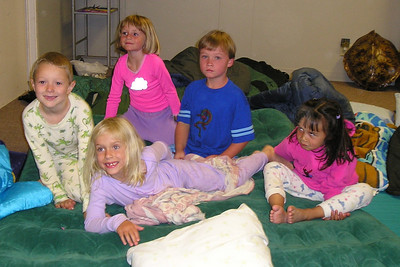 Vlad, Michaela, Sydney, Spencer and Sierra getting ready for bed during the First Baptist Day School Kindergarten class' overnight field trip to the Santa Barbara Zoo.