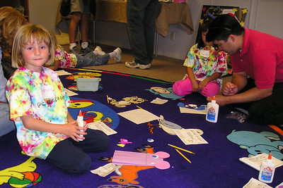 Sydney Kane is making a mouse puppet during the First Baptist Day School Kindergarten class' overnight field trip to the Santa Barbara Zoo.