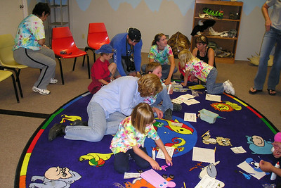 The First Baptist Day School Kindergarten class is gluing together puppets during their overnight field trip to the Santa Barbara Zoo.