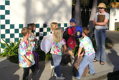 The First Baptist Day School Kindergarten class is being greeted by their host, Lauren, during their overnight field trip to the Santa Barbara Zoo.