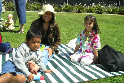 Sierra with her Aunt Candy and cousin, Isaac, at her kindergarten class' graduation party.