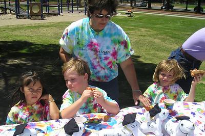 Ms. Liz, Sierra, Spencer and Sydney enjoying lunch at their kindergarten graduation party.