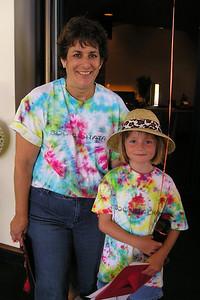 Sydney Kane with her kindergarten teacher, Ms. Liz, after their graduation ceremony.