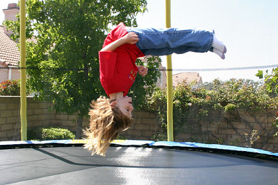 Sydney doing a flip on her new trampoline.