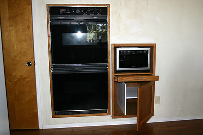 The built-in cabinet also left room for Frank's cast-iron skillets and a few of Betsy's pans as well. The cabinet also has a pull-out shelf to make it easier to stir meals being cooked. The internal divider was later covered with shelf liner.