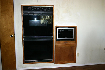 Pat Kane completed the built-in microwave cabinet for his sister, Betsy, but left it up to her to sand and stain the cabinet.