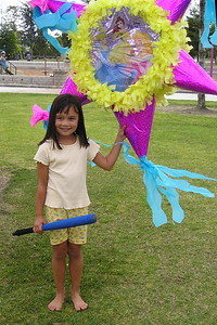 Sierra getting ready to have some fun with the pinata during her 6th birthday party.