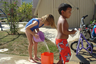 Sydney Kane and Isaac Basil playing in Luz's backyard.