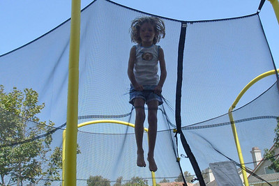 Christopher's picture of Sydney Kane bouncing on the trampoline.