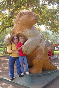 Sydney and Christopher Kane with Aunt KK next to a full-size replica of a giant ground sloth in Hancock Park.