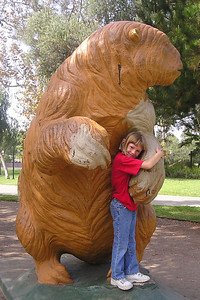 Sydney Kane next to a full-size replica of a giant ground sloth in Hancock Park.