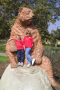 Christopher and Sydney Kane next to a full-size replica of a prehistoric bear in Hancock Park.