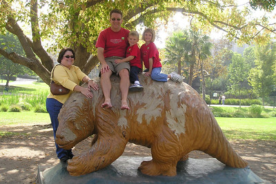 Pat, Christopher and Sydney Kane with Aunt KK (Kathy L. Kane) in Hancock Park on top of and next to a full-size replica of a giant ground sloth.