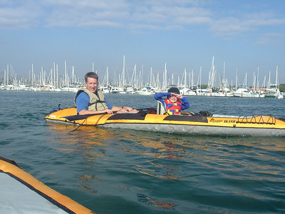 Pat and Christopher Kane ready to paddle out of Ventura Harbor. Christopher gets to take a break on the return trip as he paddled into the harbor on his own.