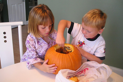 Christopher and Sydney Kane getting ready to carve their Halloween pumpkin.