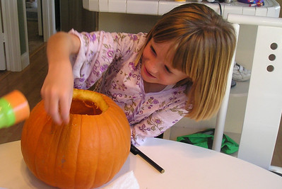 Sydney Kane is beginning to realize she doesn't like pulling out the pumpkins guts.