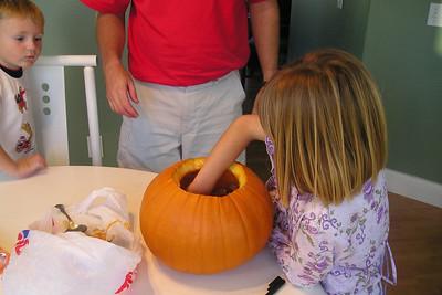 Sydney Kane getting ready to carve a Halloween pumpkin.