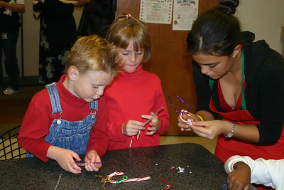 Christopher and Sydney making candy cane reindeer at the NFESC Christmas Party.