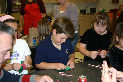 Zandler working on arts and crafts at the NFESC Christmas Party.