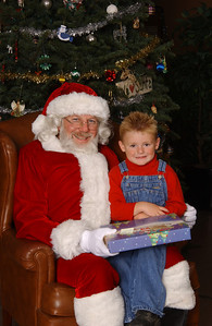 Christopher getting a picture with Santa during the NFESC Christmas Party.