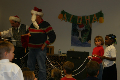 Sydney as the magician's helper during the NFESC Christmas Party.