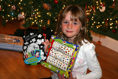 Sydney was really excited once she saw what Christopher had picked out for her--a box of stickers and velvet art posters.