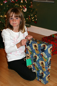 Sydney opening another gift on Christmas Eve.