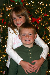 Sydney and Christopher on Christmas Eve getting ready to open their Christmas gifts.