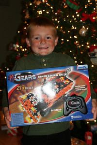 Christopher showing off his M-Gears remote control off-road truck, which was a gift from Rachel, Aunt Tracy and Uncle John. Looks like Dad is going to have fun helping him put this one together.